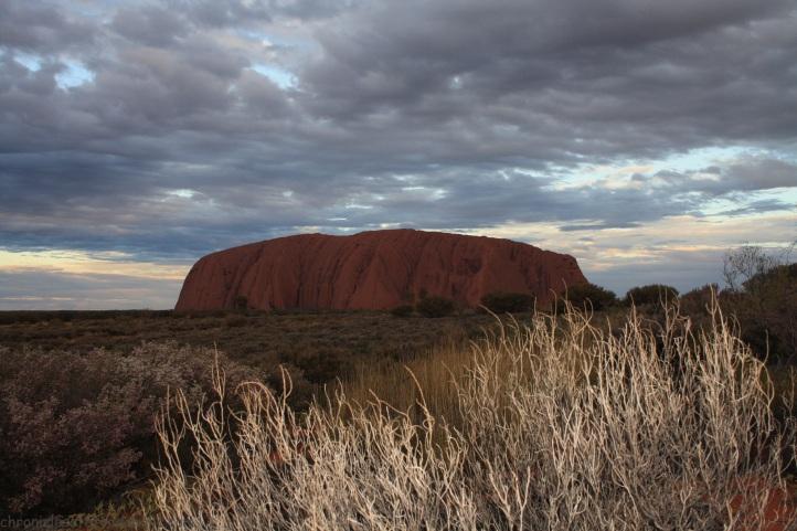 Uluru during a cloudy sunset